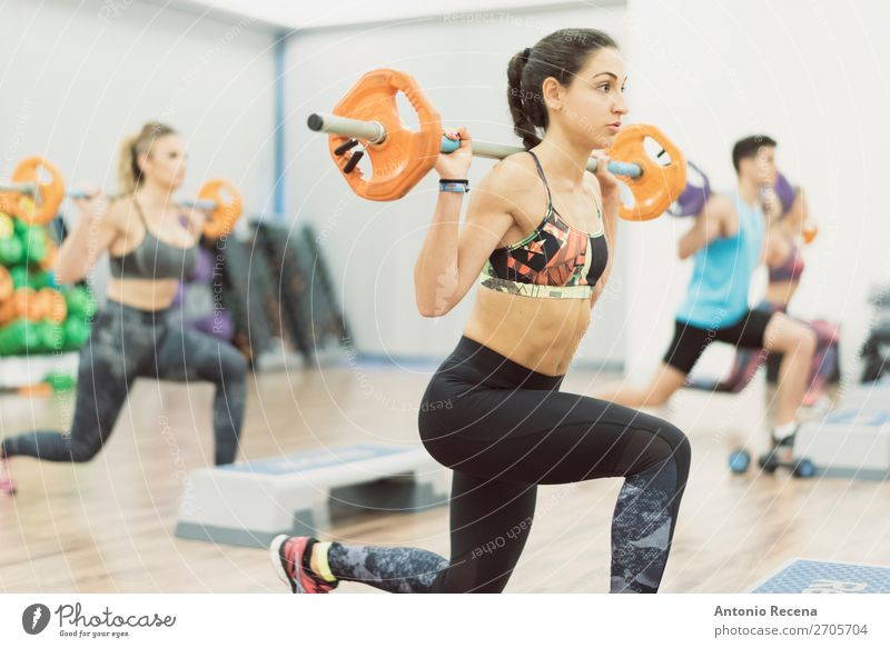 Woman in gym class training legs Lifestyle Body Wellness Adults Man Fitness Muscular Strong Power Determination Effort Caucasian Gymnasium Fitness centre