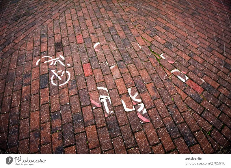 trumpet of words Bicycle Cycling Cycling tour Cycle path Traffic lane Lettering Signs and labeling Lane markings Pavement Paving stone Broken Destruction