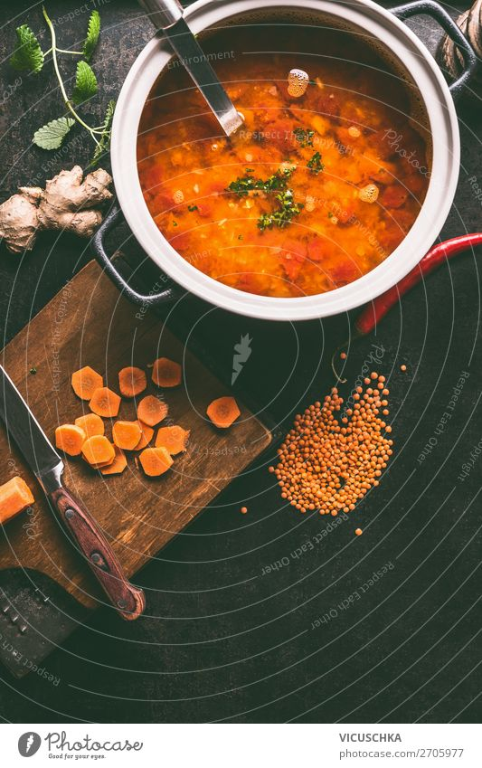 Saucepan with delicious lentil soup Food Soup Stew Lunch Organic produce Vegetarian diet Diet Pot Style Design Healthy Eating Living or residing Table Kitchen