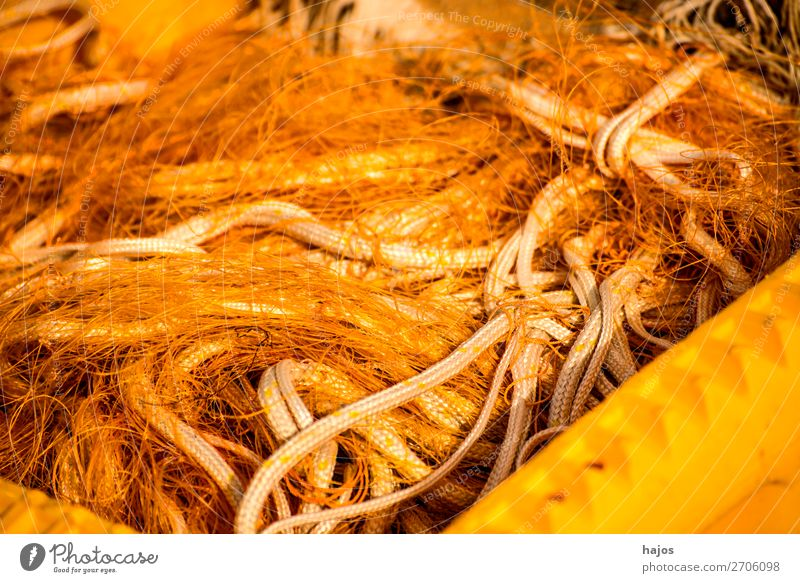 Fishing nets on a fishing boat Fishing boat Orange fishing nets Heap muddled fishing cutter accessories ropes Colour photo Exterior shot Close-up Deserted Day