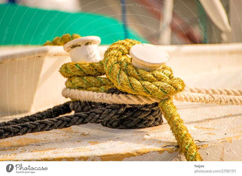 Mooring line on a fishing boat Design Navigation Fishing boat Maritime Brown Multicoloured mooring rope ropes knotted moored lashed fishing cutter pole Harbour