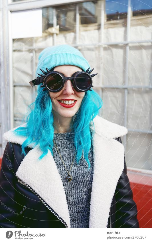 Portrait of a punk or gothic young woman smiling Woman Human being Youth (Young adults) Blue Town Colour Beautiful Clouds Joy 18 - 30 years Adults Funny