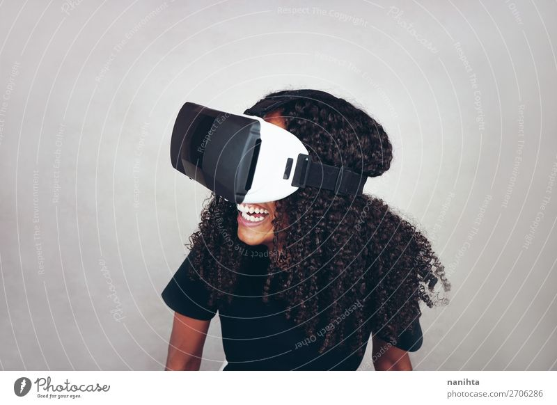 young black woman wears virtual reality VR headset Lifestyle Style Happy Beautiful Hair and hairstyles Leisure and hobbies Playing Headset Games console