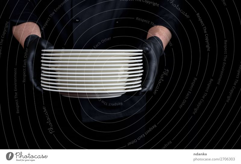 a stack of round white empty plates Plate Kitchen Restaurant Profession Human being Man Adults Hand Gloves Stand Dark Black White Stack Caucasian chef cook