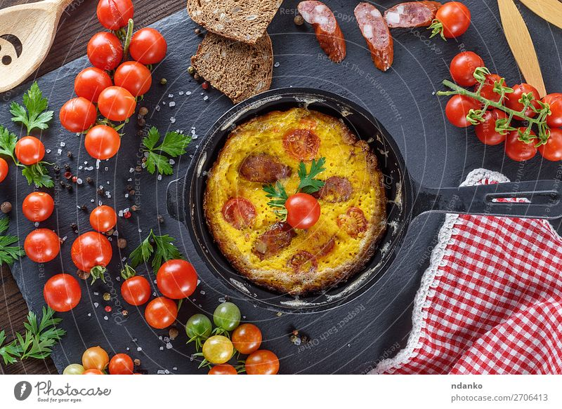 omelette from chicken eggs with red cherry tomatoes Food Sausage Vegetable Herbs and spices Nutrition Breakfast Lunch Dinner Pan Table Wood Fresh Above Yellow