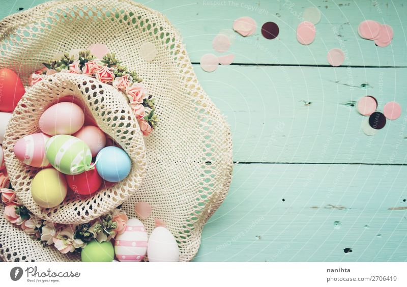 A beautiful and colorful close-up flat of easter eggs Joy Happy Beautiful Table Feasts & Celebrations Easter Nature Spring Flower Hat Wood Fresh Funny Cute