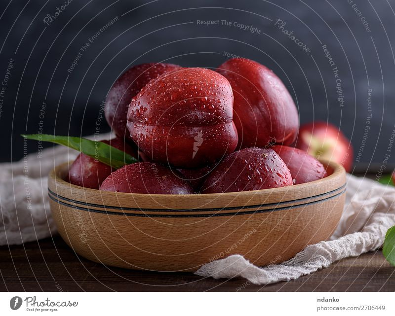ripe red peaches in a wooden bowl on a table Fruit Dessert Nutrition Vegetarian diet Diet Juice Bowl Table Nature Leaf Wood Fresh Natural Juicy Yellow Green Red