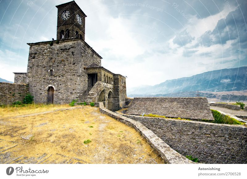 Clock tower in Gjirokastra Environment Nature Sky Clouds Horizon Weather Grass Bushes Hill Mountain Albania Town Old town Tower Manmade structures Building