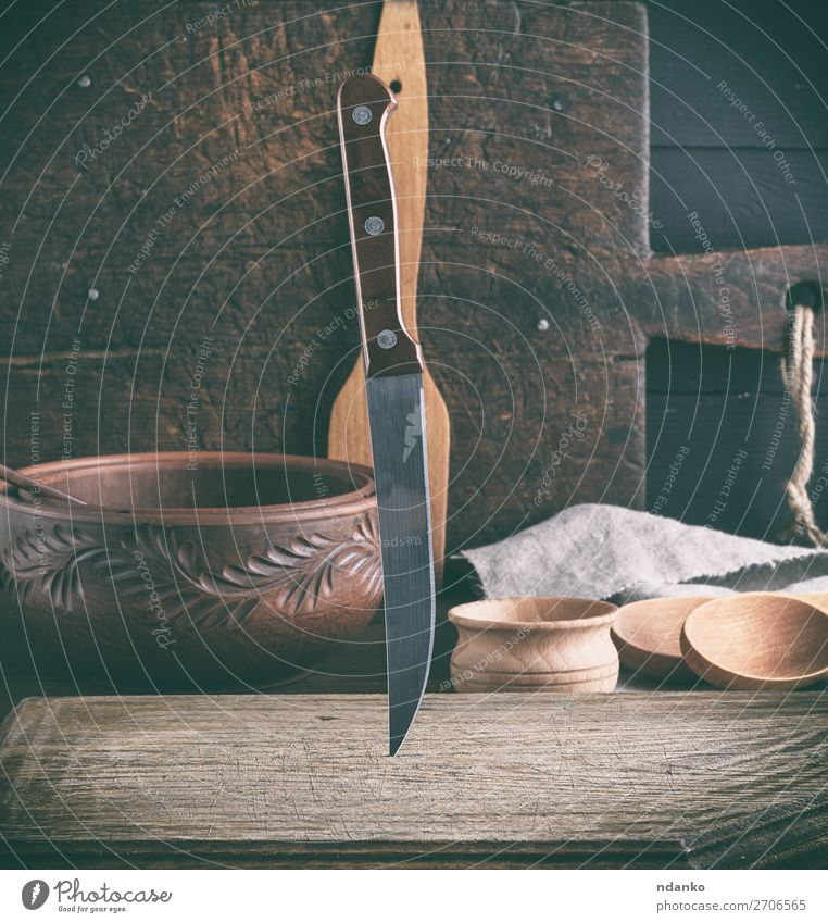 old wooden cutting board and knife Plate Bowl Knives Table Kitchen Tool Wood Metal Steel Old Brown background blade cooking Domestic equipment food handle