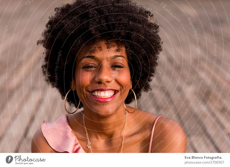 closeup portrait of a young beautiful afro american woman Lifestyle Style Happy Beautiful Hair and hairstyles Summer Sun Woman Adults Landscape Park Fashion