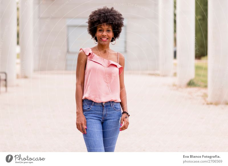 portrait of a beautiful afro american woman Lifestyle Happy Beautiful Hair and hairstyles Summer Woman Adults Landscape Park Fashion Jeans Afro Smiling