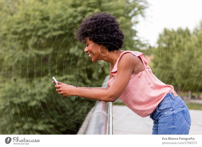 beautiful afroamerican woman talking on mobile phone Lifestyle Style Happy Beautiful Hair and hairstyles Summer To talk PDA Technology Woman Adults Nature