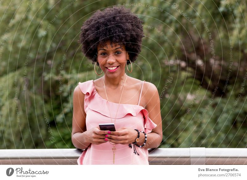 beautiful afroamerican woman using mobile phone Lifestyle Style Happy Beautiful Hair and hairstyles Summer To talk PDA Technology Woman Adults Nature Landscape