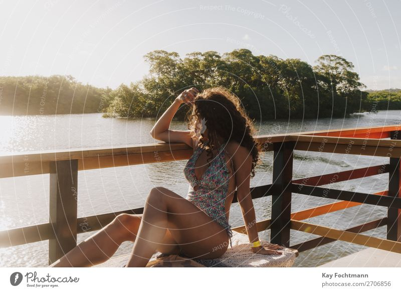 Young woman in a swimsuit looking out from the boat at mangrove bay Lifestyle Happy Harmonious Relaxation Leisure and hobbies Vacation & Travel Tourism Trip