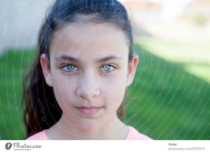 Portrait of a beautiful preteen girl with blue eyes Lifestyle Joy Happy Beautiful Face Child Schoolchild Human being Woman Adults Youth (Young adults) Hand Park