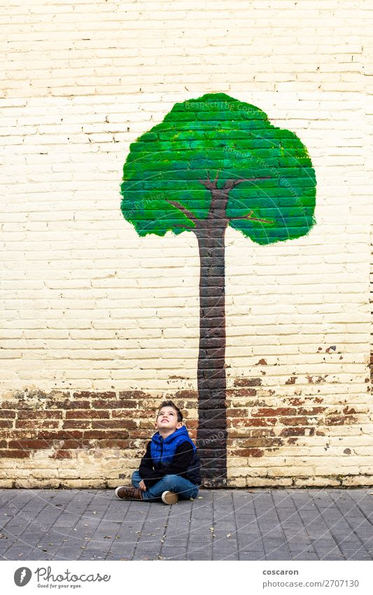 Little kid seated under a tree painted on a wall Child Human being Nature Summer Blue Town Beautiful Green Landscape Tree Leaf Calm Joy Forest Winter Life