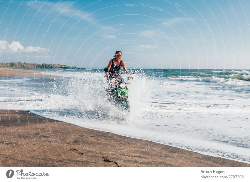 Young afro american woman riding enduro motorbike Lifestyle Vacation & Travel Trip Adventure Far-off places Freedom Beach Ocean Waves Sports Motorsports
