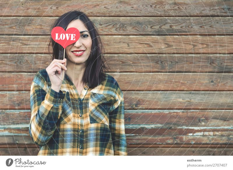 Love,young woman with a heart covering his eye Lifestyle Style Joy Beautiful Face Vacation & Travel Summer Feasts & Celebrations Valentine's Day Human being