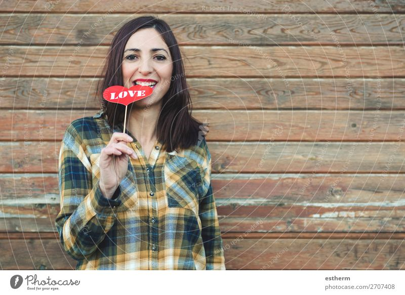 Love,young woman holding a lollipop in his mouth Lifestyle Style Joy Beautiful Face Feasts & Celebrations Valentine's Day Human being Feminine Young woman