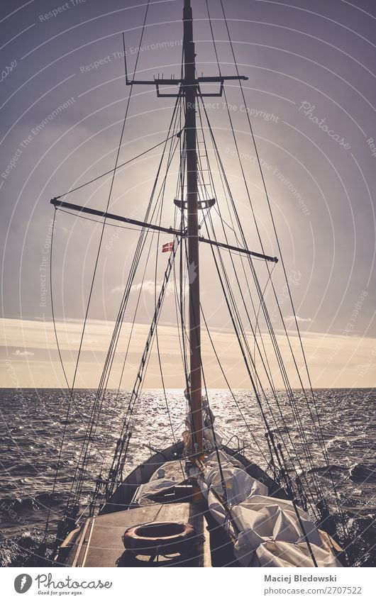 Old schooner sailing at sunset. Lifestyle Vacation & Travel Trip Adventure Far-off places Freedom Cruise Sun Ocean Waves Sailing Sky Horizon Wind Navigation