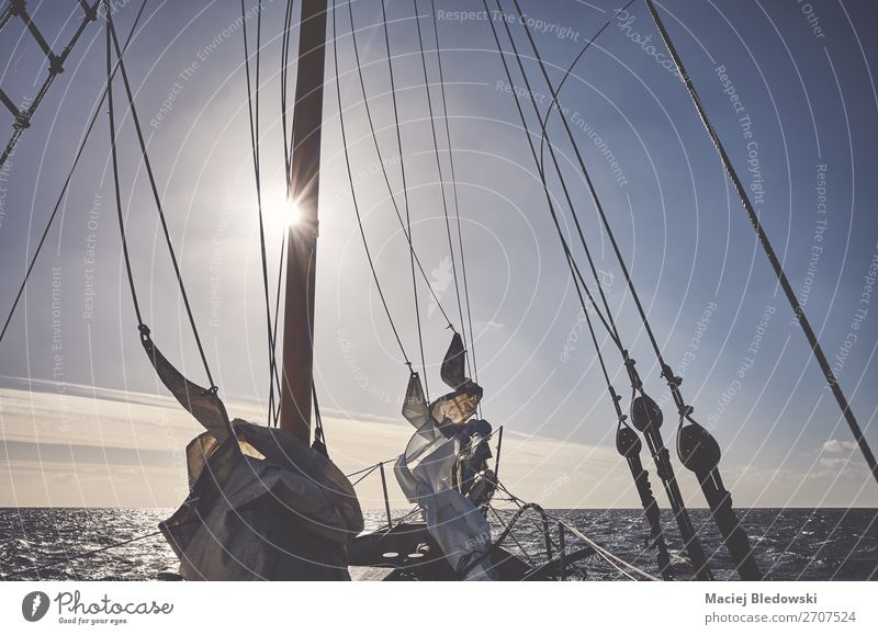 Mast of an old schooner sailing at sunset. Lifestyle Vacation & Travel Adventure Far-off places Freedom Cruise Sun Ocean Sailing Sky Horizon Wind Transport