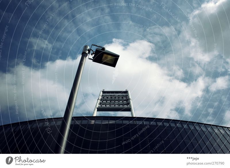 warrior of light. Bremen Illuminate Stadium Weser Stadium Street lighting Lamp post Floodlight Clouds Clouds in the sky Stands Modern Modern architecture