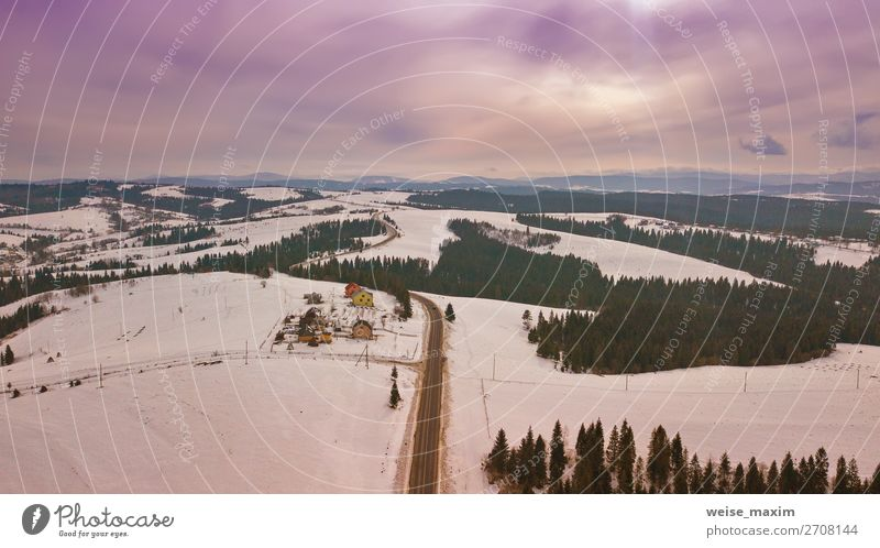 Aerial rural view of road passing to horizon. Vacation & Travel Nature White Landscape Tree House (Residential Structure) Clouds Forest Winter Far-off places