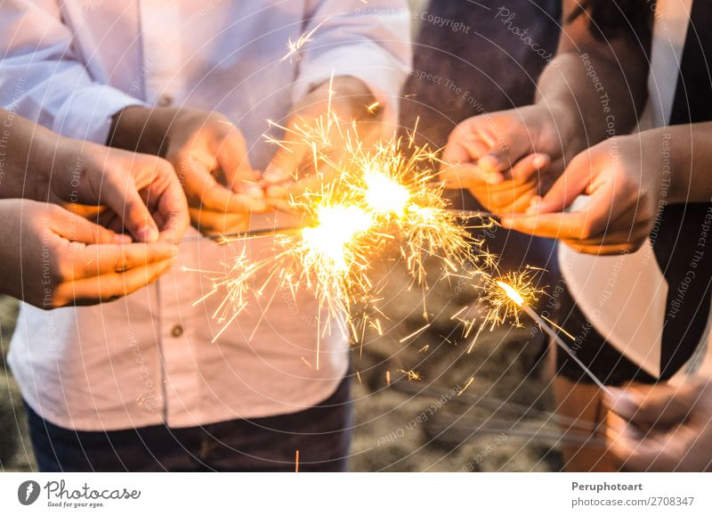Beautiful sparklers in people hands, xmas and new year concept. Joy Happy Winter Decoration Feasts & Celebrations Christmas & Advent New Year's Eve Birthday