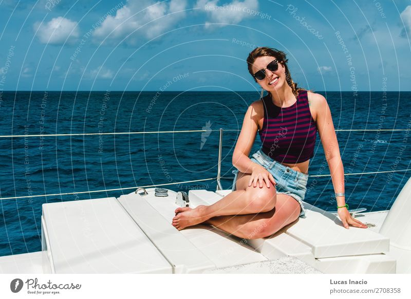 Girl in a boat near Saona Island, Dominican Republic Happy Vacation & Travel Tourism Summer Beach Ocean Woman Adults Environment Nature Sand Coast Watercraft