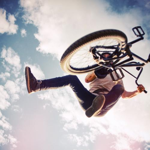 BMX Tailwhip Sports Cycling Bicycle Human being Young man Youth (Young adults) 1 18 - 30 years Adults Youth culture Sky Clouds T-shirt Jeans Sneakers Jump