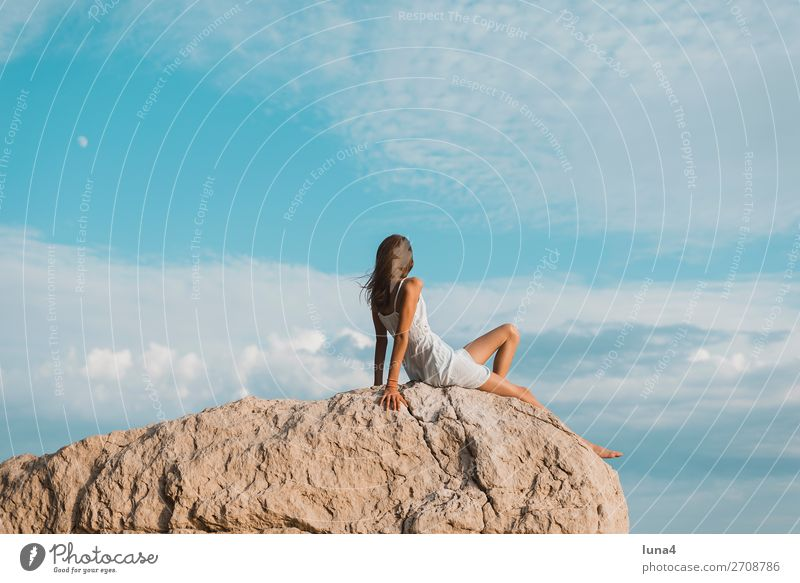 Girls on rocks Lifestyle Happy Relaxation Calm Leisure and hobbies Vacation & Travel Tourism Summer Environment Nature Landscape Water Rock Coast Dress Sit