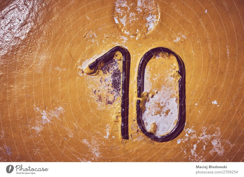 Number ten on yellow painted steel background. Wallpaper Steel Sign Digits and numbers Old Dirty Authentic Creepy Gloomy Yellow 10 Grunge vintage stain filtered
