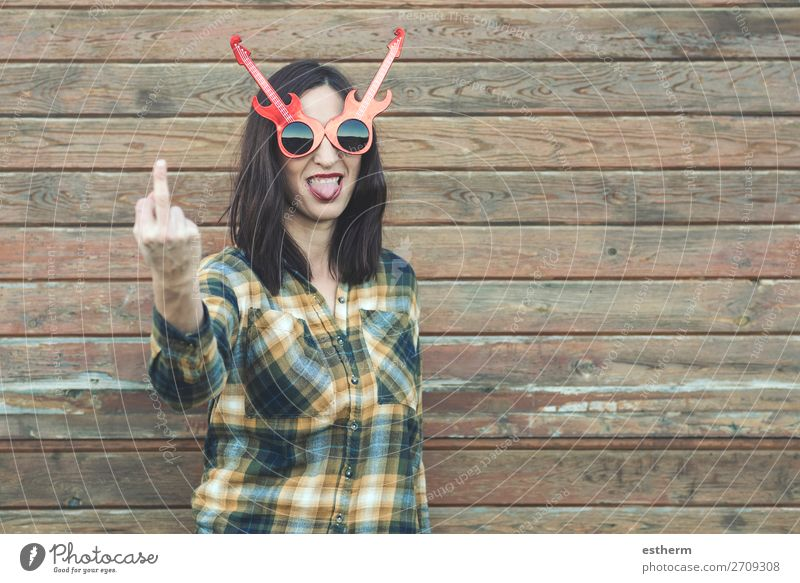 Portrait of young woman insulting with finger Lifestyle Beautiful Music Human being Feminine Young woman Youth (Young adults) Woman Adults 1 30 - 45 years Punk