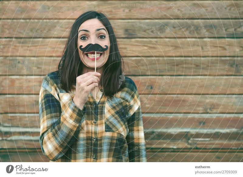 Funny young woman holding mustache on stick Lifestyle Joy Happy Entertainment Event Feasts & Celebrations Carnival Fairs & Carnivals Human being Feminine