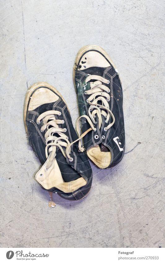Kick it. Footwear Sneakers Blue Black White Chucks Broken Shoelace Colour photo Interior shot Copy Space top Neutral Background Deep depth of field