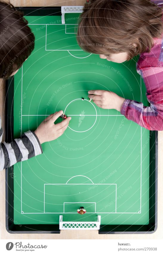 kicked off Playing 2012 Bird's-eye view Table soccer Child Striped Center circle Colour photo