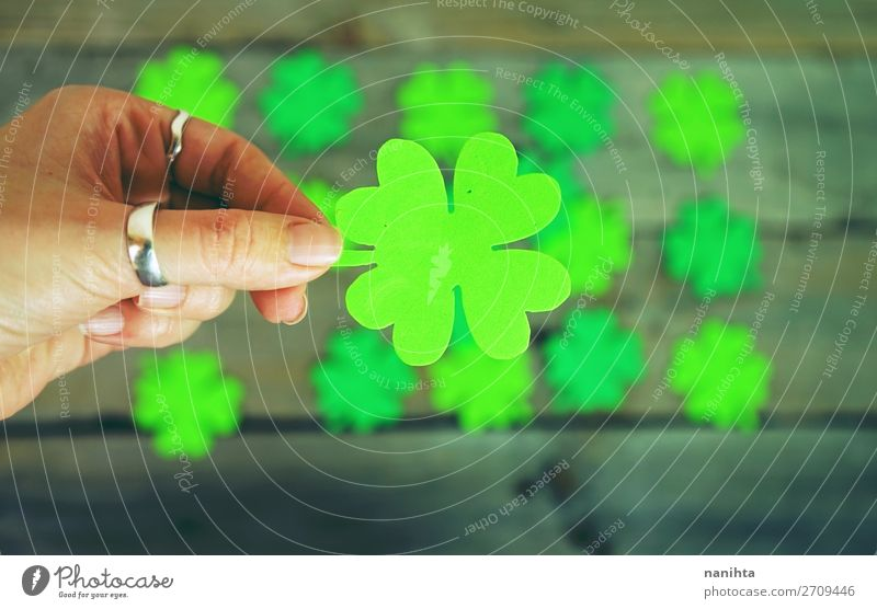 Beautiful close-up of woman hand holds a clover Woman Colour Green Hand Leaf Adults Wood Happy Feasts & Celebrations Style Design Culture Table Creativity Paper