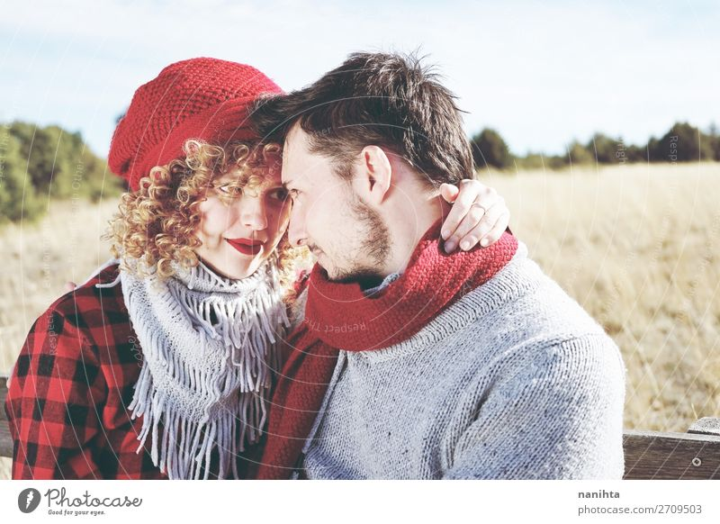 Romantic young couple of lovers look at each other Woman Human being Man Beautiful Red Lifestyle Adults Wood Autumn Love Funny Feminine Family & Relations Happy