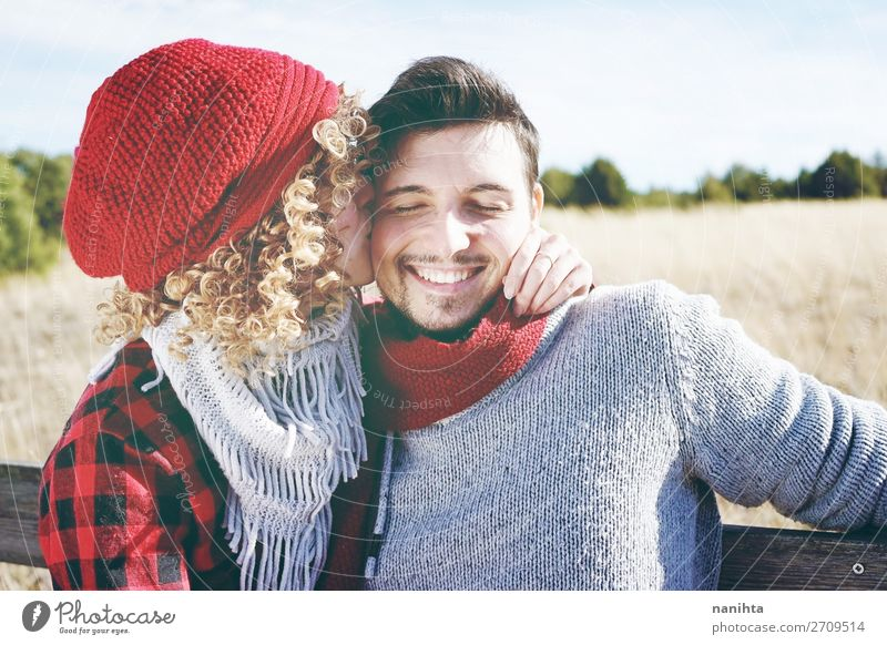 Romantic young couple of a kissing Woman Human being Man Beautiful Red Joy Lifestyle Adults Wood Autumn Love Funny Family & Relations Happy Couple