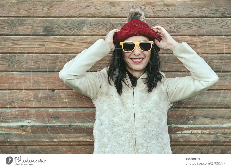 Young woman with cap and Sunglasses in winter Lifestyle Joy Vacation & Travel Trip Winter Snow Human being Feminine Youth (Young adults) Woman Adults 1