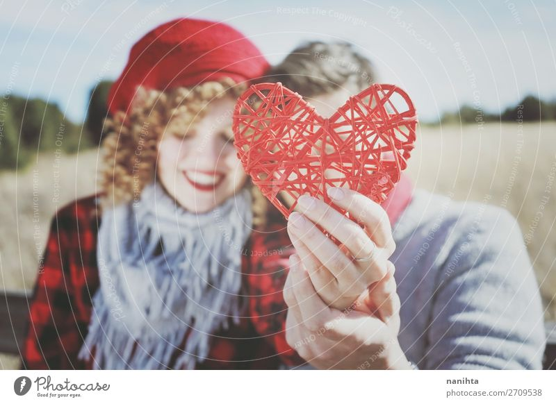 close-up of a beautiful red heart held by a romantic couple Woman Human being Man Beautiful Red Joy Lifestyle Adults Wood Autumn Love Funny Feminine