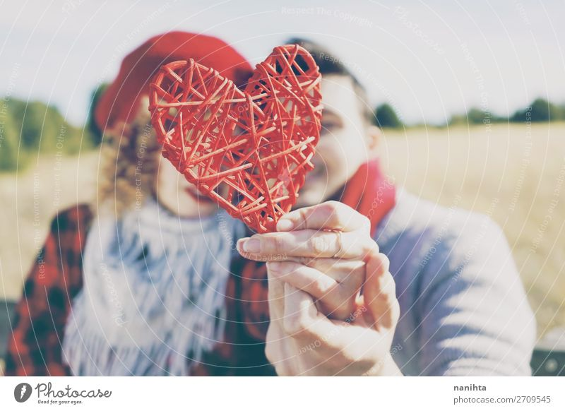 lose-up of a beautiful red heart held by a couple Woman Human being Man Beautiful Red Healthy Lifestyle Adults Wood Autumn Love Funny Feminine