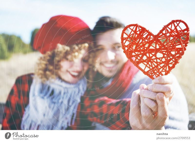 close-up of a beautiful red heart holding by a couple Woman Human being Man Beautiful Red Joy Lifestyle Adults Wood Autumn Love Funny Feminine