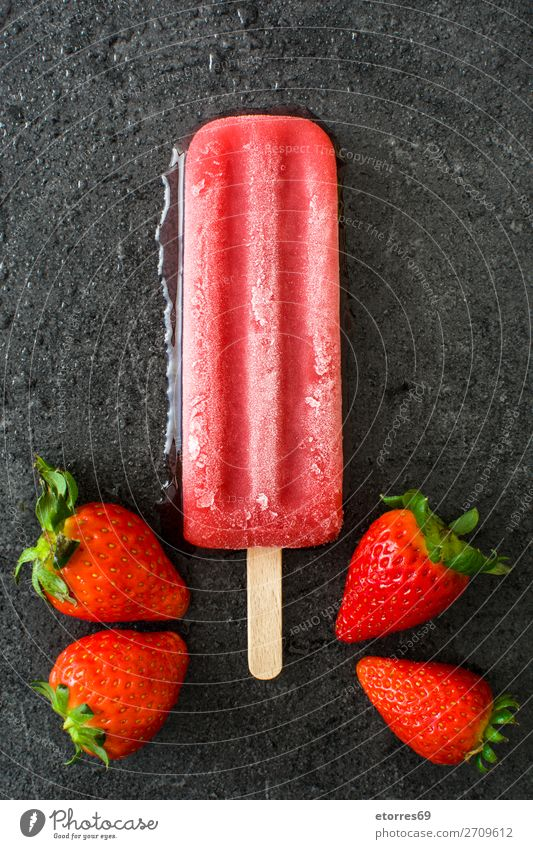Strawberry popsicle on black slate background Food Healthy Eating Food photograph Fruit Dessert Ice cream Candy Fresh Cold Sweet Red Black Summer