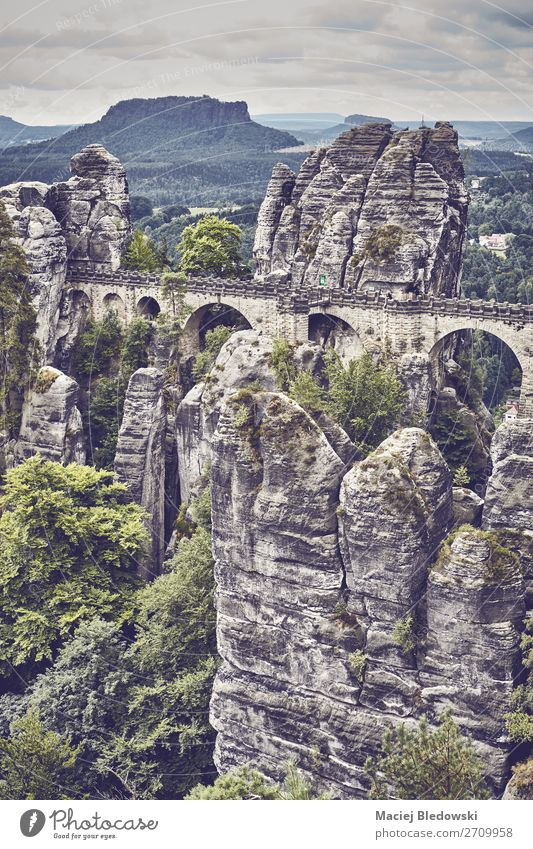 Retro toned picture of the Bastei Bridge, Germany. Vacation & Travel Tourism Trip Adventure Sightseeing Mountain Hiking Nature Landscape Tree Park Forest Rock