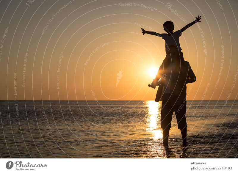 Father and son playing on the beach at the sunset time. Lifestyle Joy Happy Relaxation Leisure and hobbies Playing Vacation & Travel Trip Adventure Freedom