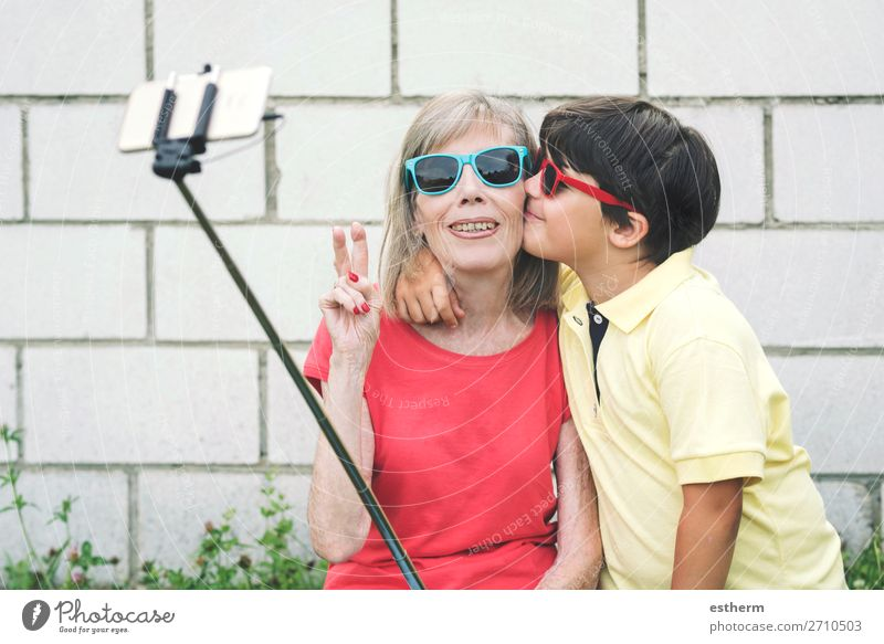 Grandmother and Grandson taking selfie using smartphone Lifestyle Joy Retirement Cellphone Camera Human being Masculine Feminine Female senior Woman