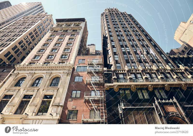 Looking up at old New York buildings, USA. Lifestyle Shopping Luxury Downtown Old town Building Architecture Facade Retro Nostalgia City Manhattan Fire ladder