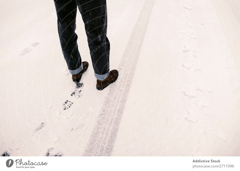 Person standing on snowy road Street Snow Winter Asphalt trace Legs Stand Human being Nature Cold Landscape White Seasons Frost Day Frozen Trip Transport