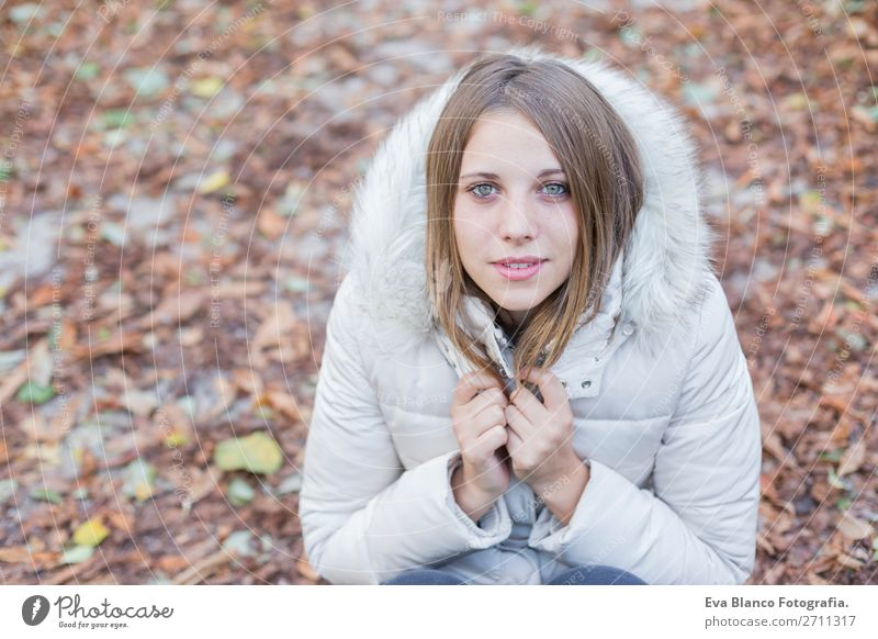 portrait outdoors of a beautiful woman in winter season Lifestyle Style Happy Beautiful Winter Woman Adults Lips Nature Autumn Weather Leaf Park Fashion Coat